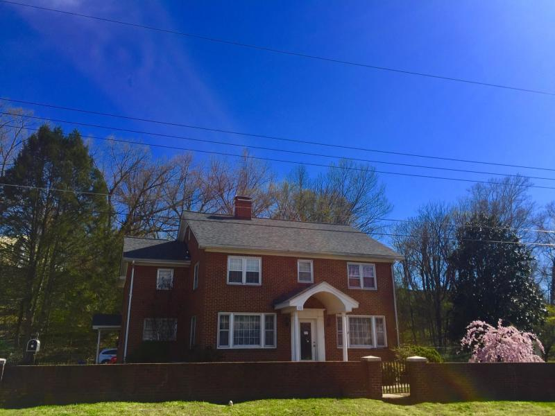 118 W 28th St, Buena Vista, VA 24416 MLS #133980  Stately Two Story Brick home with Tons of space, Large 4 city lot fenced yard. Two bedroom apt. with great space as well. A prime Property for primary residence or investment. This home offers much charm with its lovely Lovely large Kitchen with built in seating, living room with fireplace, dining room, family room, bonus room or additional bedroom, 1.5 bath in main house. Apt. has beautiful kitchen and dining room, large living room, two bedrooms large bath & washer dryer, . Great level lot with garage, fire pit, above ground pool, Volleyball net, fruit trees, 6 parking spaces. The Students love to meet here for gatherings. This home could offer up to 5+/- possible bedroom, 5 walk-in Closets. Off street parking. Walk to SVU as it is just beyond your back yard. Can convert to single home