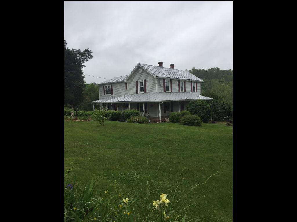 2819 Forge Rd, Glasgow, VA 24555 MLS #135145  This 2.07 acre farm house was recently renovated & has a large addition.. Wrap porch, & privacy. This home is like a new home, move-in ready. The Addition includes Huge custom kitchen eat-in kitchen, with bay window, cherry cabinets, granite counter tops, island, propane gas cook range with 2.5 ovens. Opens to large dining room, dining set conveys with acceptable offer. Main floor also offers a living room and bonus room with a show, half bath just off bonus room. Utility off dining area. The upstairs has a large master suite & office, master bath with jetted tub, & Glass door shower. There are two additional bedrooms and bath on upstairs level. This home offer lovely wood floors. Large single car garage workshop with electricity,two storage building with new roofs & a storage shed.